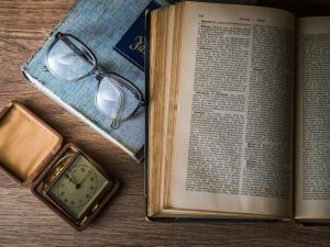 book, glasses, watch